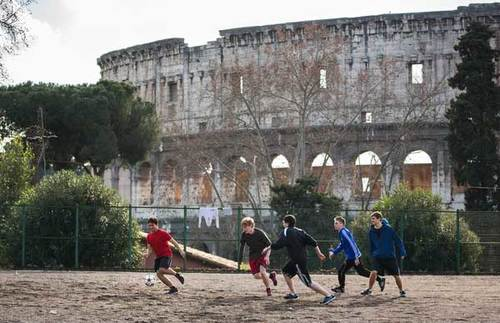 Students play soccer next to the Colosseum, near the Notre Dame Rome Centre