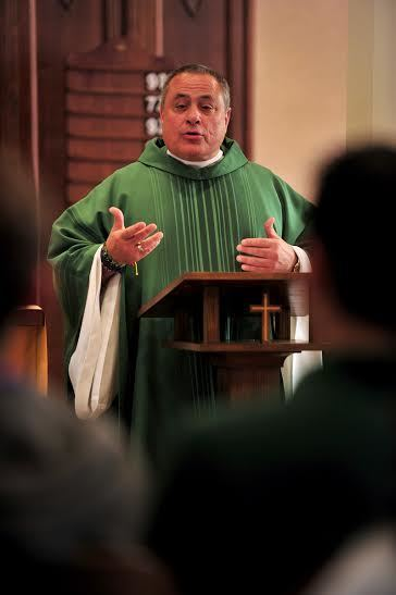 Fr Joe Corpora gives a homily during Mass