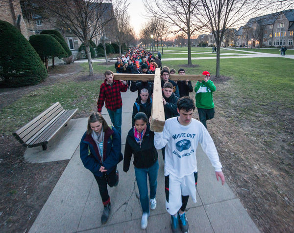 Students pray the Stations of the Cross on campus