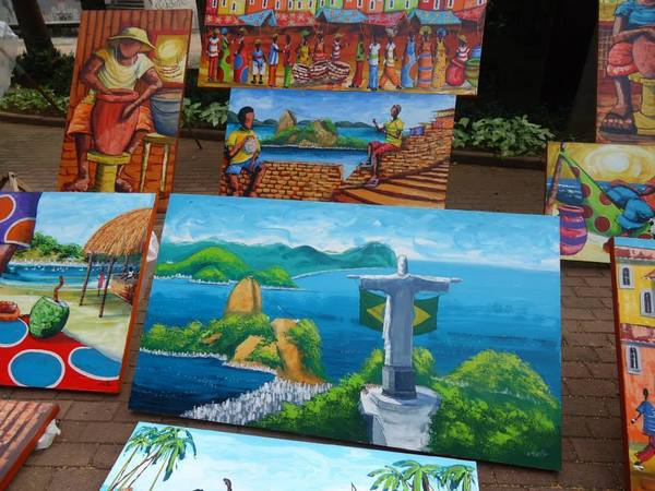 Paintings being sold at an outdoor market in Campinas, Brazil